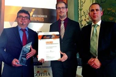 Bild der Preistraeger Andreas Gramm mit dem IAB-Forscherteam Thomas Roske und Dr. Justus Lipowsky